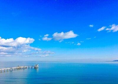 Naklejka Scenic View Of Sea Against Blue Sky