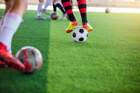 selective focus to soccer player control ball with jump and stomp for shoot to goal, training to trap and control football.