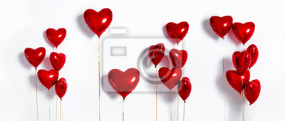 Naklejka Set of Air Balloons. Bunch of red color heart shaped foil balloons isolated on white background. Love. Holiday celebration. Valentine's Day party decoration. Metallic red  Heart air balloons
