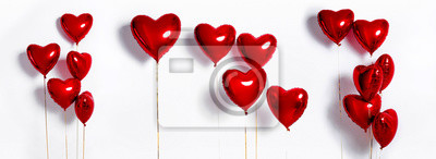 Set of Air Balloons. Bunch of red color heart shaped foil balloons isolated on white background. Love. Holiday celebration. Valentine's Day party decoration. Metallic red  Heart air balloons