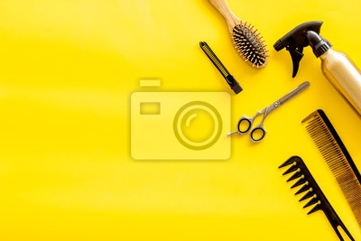 Naklejka Set of professional hairdresser tools with combs and styling on yellow background top view mock up