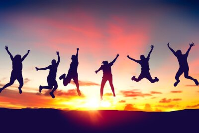 Naklejka Silhouette happy friends jump on sunset sky at top of mountain abstract background.