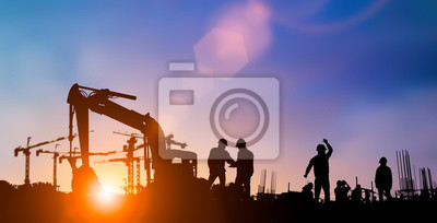 Naklejka Silhouette of engineer and construction team working at site over blurred background for industry background with Light fair.Create from multiple reference images together