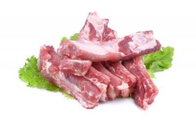 Naklejka Sliced pork ribs on a lettuce leaf are isolated on a white background.Preparation of meat dishes.