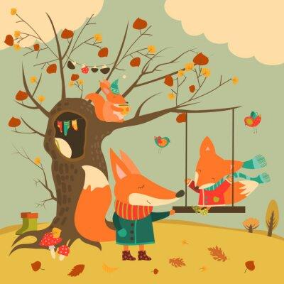 Naklejka Śliczne lisy jeździć na huśtawce w lesie jesienią