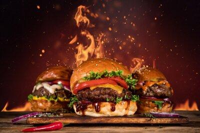 Naklejka Smaczny burger z frytkami i ogniem.