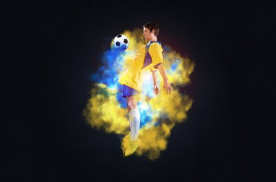 Soccer player jumping with ball in smoke