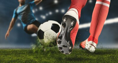 Naklejka Soccer player making sliding tackle