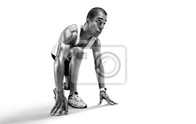 Naklejka Sports background. Runner on the start. Black and white image isolated on white.