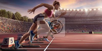 Naklejka Sprint kobiet sportowców. Trzy kobiety w sportowych ubraniach biegają na bieżni na profesjonalnym stadionie