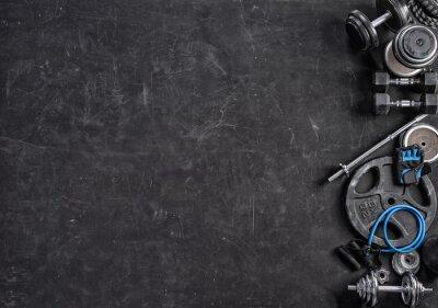 Naklejka Sprzęt sportowy na czarnym tle. Widok z góry. Motywacja