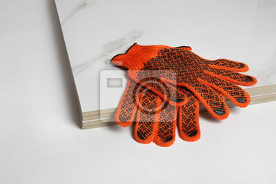 Stack of ceramic tiles and gloves on white background. Space for text