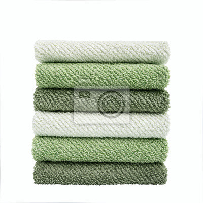 Stack of green towels. Isolated over white
