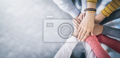 Naklejka Stack of hands. Unity and teamwork concept.
