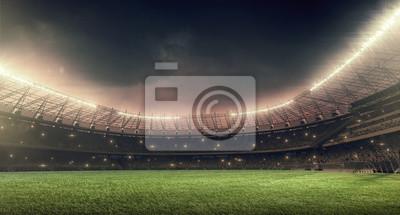 Naklejka Stadion piłkarski z zieloną trawą, światła iluminacji i dramatyczne niebo nocne