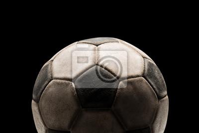 Stary piłka nożna na czarnym tle