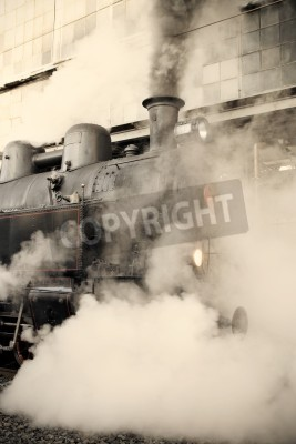 Naklejka Steam locomotive at the railway station wrapped up in cloud - vintage retro tinting