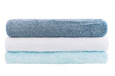 Sterta błękitni i biali ręczniki odizolowywający nad bielem