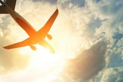 Naklejka Stonowanych zdjęcie samolocie w słońcu