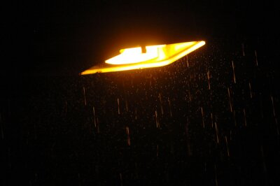 Street lamp on a rainy night.