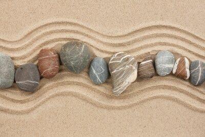 Striped kamienie na piasku
