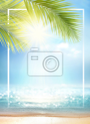Naklejka Summer background with frame, nature of tropical golden beach with rays of sun light and leaf palm. Golden sand beach close-up, sea water,  blue sky, white clouds. Copy space, summer vacation concept.