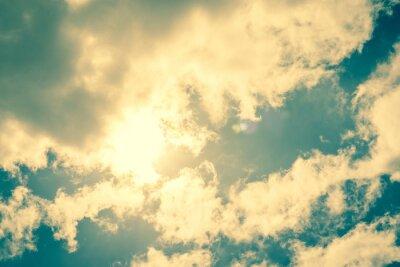 Naklejka Sun breaking through clouds