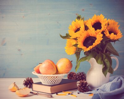 Naklejka Sunflowers bouquet in white vase with apples