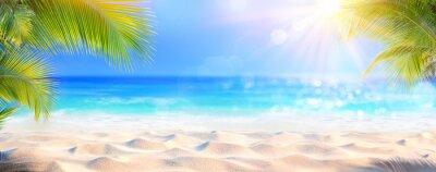 Naklejka Sunny Tropical Beach With Palm Leaves And Paradise Island