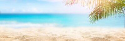 Naklejka Sunny tropical beach with palm trees