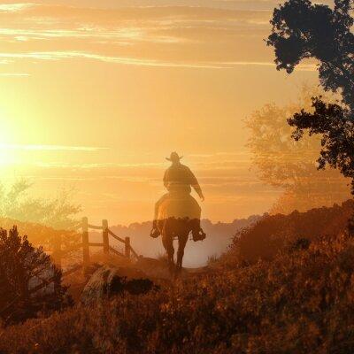 Naklejka Sunset Cowboy. Kowboj jedzie od do zachodu słońca w przezroczystych warstw pomarańczowe i żółte chmury, ogrodzenia i drzew.