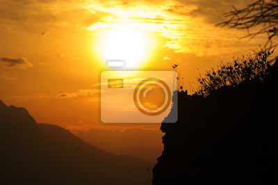 Sunset with mountains and shades of yellow