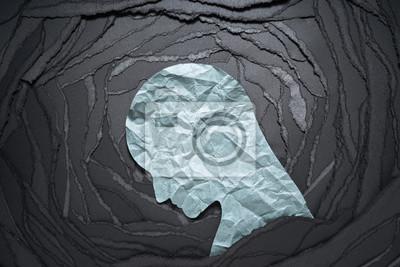 Naklejka Sylwetka głowy osoby depresji i lęku. Negatywny obraz emocji. Głowa osoby w kształcie papieru na tle czarny papier rozdarty.