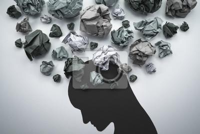 Naklejka Sylwetka niespokojnej głowy osoby. Koncepcja obrazu niepokoju i negatywnych emocji. Makulatura i sylwetka głowy.