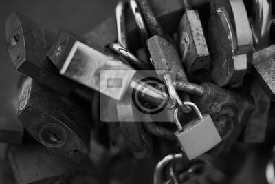 Symbolic love padlocks fixed to the railings. Black and white