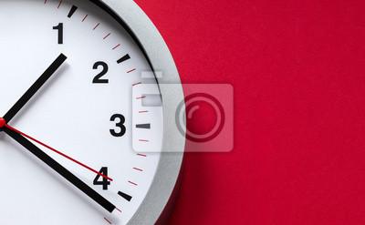 Naklejka tarcza zegara na czerwonym tle