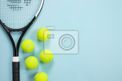 Naklejka Tennis ball and racket isolated background. Top view