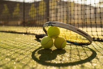 Naklejka Tennis game. Tennis ball with racket on the tennis court. Sport, recreation concept.