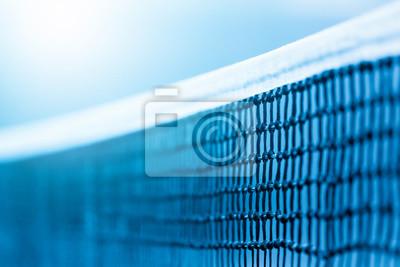Naklejka Tennis net and blue court. Individual sport. Blue filter