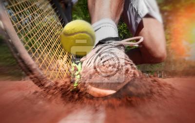 Naklejka Tennis player on clay tennis court