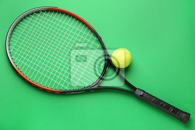 Naklejka Tennis racket and ball on color background