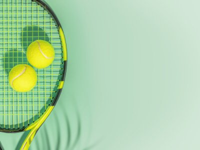 Naklejka Tennis. Spring sport composition with yellow tennis ball and racket on a green background of tennis court with copy space. Sport and healthy lifestyle. The concept of outdoor game sports. Flat lay