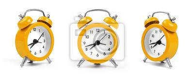 Naklejka Three yellow alarm clock over white