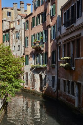 Traditional narrow canal in Venice, Italy.