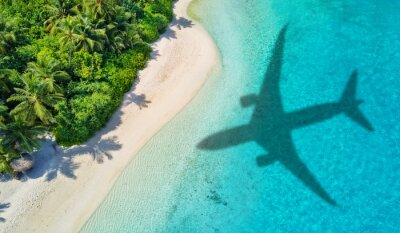 Naklejka Travel concept with airplane shadow and beach