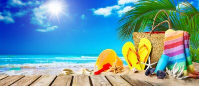 Naklejka Tropical beach with sunbathing accessories, summer holiday background