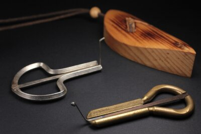 Two jew's harps, traditional music instruments of Altai and Yakut people, also known as carpathian drymba or vargan shot on black background, close up view