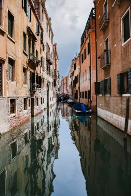 Typical Venice narrow canal with boats. Italy