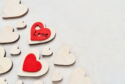 Valentines Day background with wooden hearts on a concrete background, top view. Valentines Day concept. Copy space