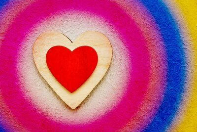 Valentines Day background with wooden hearts on colorful concrete background, top view. Valentines Day concept